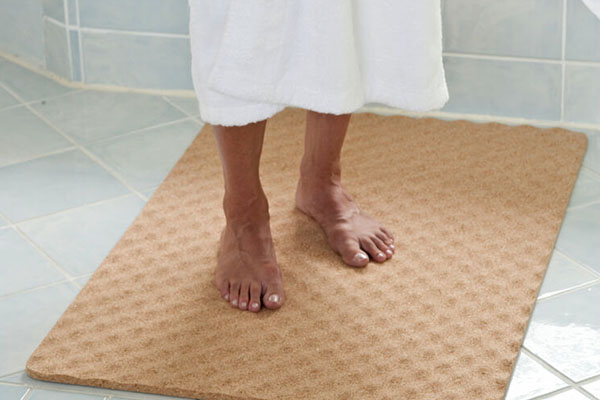 image of senior stepping on shower mat